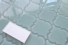 Bring a touch of elegance to your new new kitchen backsplash or bathroom with our Seaside Arabesque Glass Tiles. These tiles are stunning! The color is an aqua blue green. Consider mingling other colo
