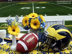 University of Michigan, football-themed, coed wedding shower tablescape. Floral design by Something Floral / Something Spectacular, Warren, MI. Photo by Urban Fire Studio, Warren, MI. #UofM #Michigan #UMich #GoBlue #BigHouse #Stadium #football