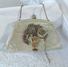 Silver crown wedding clutch named Queen Zoi La Beu.  She went to the most romantic wedding.....a true love story.