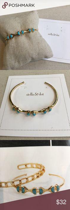 Turquoise Stone Cuff Semi-precious turquoise geometric stones sit in a striking shiny gold plated Cuff.  Never worn with original box. Stella & Dot Jewelry Bracelets