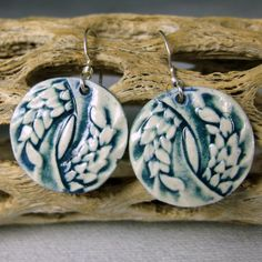Feathers In Peacock Porcelain Earrings With Sterling Silver Earwires. $16.00, via Etsy.