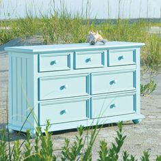 Refurbishing a dresser. Thinking of this robin's egg blue color with metal hardware.