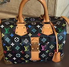 Louis Vuitton Speedy 30 Multicolor Shoulder Bag. Get one of the hottest styles of the season! The Louis Vuitton Speedy 30 Multicolor Shoulder Bag is a top 10 member favorite on Tradesy. Save on yours before they're sold out!