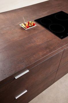 Copper finish from the Neolith Iron Collection brings unique texture to the kitchen
