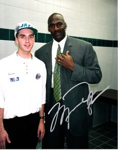 "Courtesy of Preston Truman Former Utah Jazz ballboy Preston Truman stands with Michael Jordan after the ""Flu Game,"" in which Jordan led the bulls to a 3-2 NBA Finals lead on June 11, 1997."
