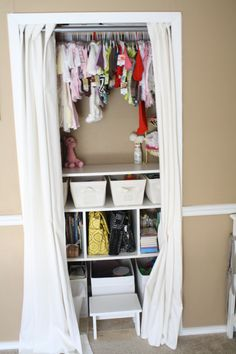 Small closet organization. The picture and website are for a nursery, but I rather like the idea of having a shelf with bins in a small closet!
