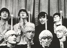 The Beatles pose with sculptures of themselves. Circa 1964