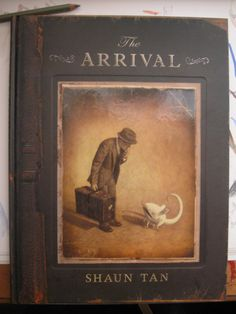 """The Arrival"" by Shaun Tan. A book without words that made me cry! Wonderfully illustrated graphic novel."