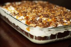Ingredients: 1 package devil's food chocolate OR German chocolate cake mix 1 14 oz can sweetened condensed milk 1 jar caramel topping 1 8oz tub cool whip 4-5 snickers bar (my preference) you can use skor, heathbar, or mini reeses Directions: Bake