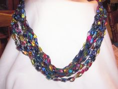 Directions for crocheted neckalces; saw these at a show this weekend and they were gorgeous in different colors! Almost like wearing a scarf, but lighter weight and not as bulky. Looked easy to make...