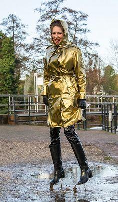 Shiny gold metallic raincoat and muddy boots