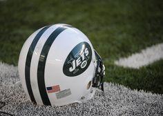 New York Jets helmet on the football field.