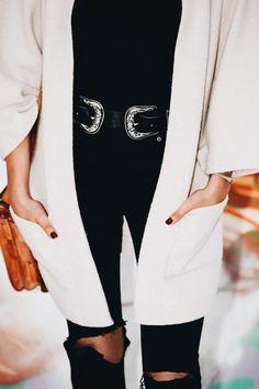 Winter white jacket over all black.