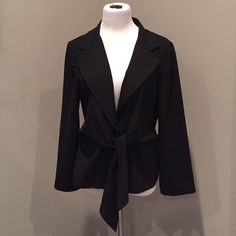 DKNY Wrap Blazer Perfect condition. Open blazer with one hidden button closure and attached tie. When tied at the front you get a sleep figure flattering look. 95% wool 5% elastane DKNY Jackets & Coats