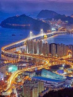 Aerial view of Busan, South Korea. Busan, latinized Pusan before is South Korea's second largest metropolis after Seoul. Places Around The World, The Places Youll Go, Places To See, Around The Worlds, Busan South Korea, South Korea Travel, North Korea, Seoul Wallpaper, Republik Korea