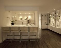 KM Townhouse, New York City Stylist Kevin Mancuso  This design is very simplistic and white. Everything is very orderly and this is exactly what you would think a medi spa would be.