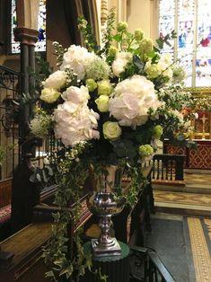 Large formal white and cream church pedestal arrangement with hydrangeas, viburnum and alliums