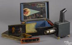 German Earnest Plank Magic Lantern, in its original box, with twelve glass slides