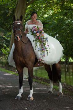 July wedding bouquet for a bride on horseback using British summer flowers such as clematis, plumbago, zinnias, roses, nigella, weeping birch, myrtle & fatsia. www.wildandwondrousflowers.co.uk