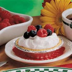 Yogurt Berry Pies Recipe -These pies have just two ingredients in the filling, so they're a snap to assemble. yet they look and taste like you fussed. Topped with fresh blueberries and raspberries, they're irresistible.—Dawn Fagerstrom, Warren, Minnesota