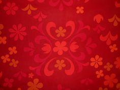 origineel retro fleurige rood/oranje/roze bloemenprint. 1.20 breed en 7,50 per meter.