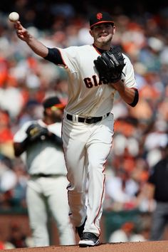 SAN FRANCISCO, CA - SEPTEMBER 28: Rookie pitcher Chris Heston #53 the San Francisco Giants throws to first base in his major league debut in a game against the San Dieigo Padres in the first inning at AT&T Park on September 28, 2014 in San Francisco, California. (Photo by Brian Bahr/Getty Images)