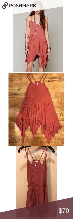 """Free People Tattered Up Slip Dress Been worn twice. No sign of wear. This super soft racerback slip dress features double spaghetti straps and frayed design, accentuated in its uneven hemline. Color: Rust 100% Rayon Machine Wash Cold Import Bust: 36.0"""" = 91.44 cm Length: 31.0"""" = 78.74 cm Free People Dresses Asymmetrical"""