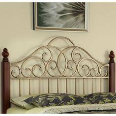 Create a romantic feel for your bedroom with this California king headboard. Featuring wood posts in a cinnamon cherry finish and beautiful metalwork with a gold finish, this headboard is sure to make a big impression in your elegant boudoir.