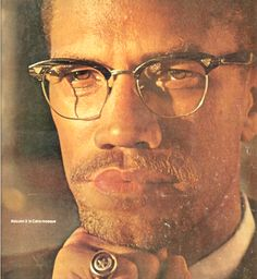 sharp pic of Malcolm wearing sharp glasses.