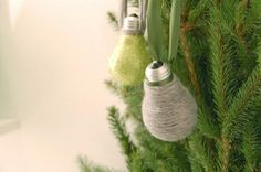 grey and green christmas tree ornaments - glitter and yarn