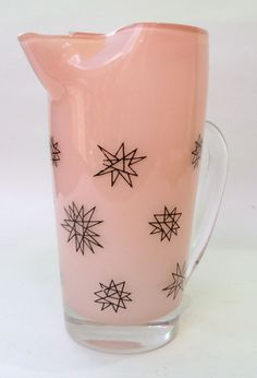 """Pale pink martini pitcher with classic Mid- Century """"atomic"""" starburst design."""