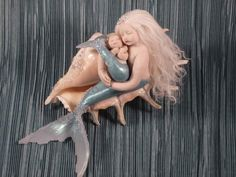 Handmade one-of-a-kind polymer clay mermaid and mermaid baby by Mermaids Dreaming  www.facebook.com/mermaidsdreaming