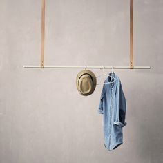 MINIMAL CEILING HUNG CLOTHES RACK BY DANISH INTERIORS BRAND FERM LIVING. THE MULTI-USES OF THIS SIMPLE, CLEVER DESIGN ARE ENDLESS! SHORT ON SPACE IN YOUR BEDROOM? THIS HANGING DISPLAY CAN BE USED TO STORE YOUR CLOTHING AND ACCESSORIES. LOOKING TO INJECT A LITTLE CREATIVITY INTO YOUR HOME OFFICE? EXPLORE THE ALTERNATIVE WAYS TO DISPLAY YOUR FAVOURITE JOURNALS, CARDS AND MEMOS!