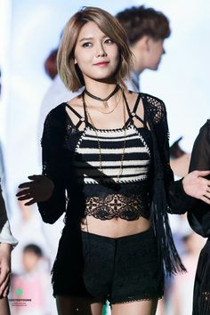 Choi Sooyoung wearing a black strappy bra under her top.