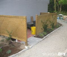 How to hide your garbage cans. You should see the before picture!!!