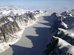 Ice covered fjord on Baffin Island with Davis Strait in the background.