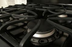 Clean cast iron grates each time you deep clean your stove to keep them looking their best.