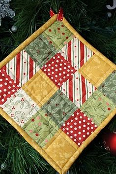 4 Christmas hotpads - love that she decorated the tree with them for a sweet country appeal! :D These would make a great gift too!