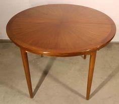 A Danish era solid teak mid century extension dining table with beautiful radiating veneer top.