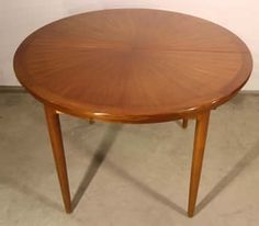 A Danish era solid teak mid century extension dining table with beautiful radiating veneer top.