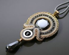 Beautiful, impressive soutache necklace, made of soutache strings with Onyx and glass beads.  Necklace have been impregnated.  Full length: 7.2 inches.  Length of string: 18.8 inches  Colour: black, beige, ecru and gold.