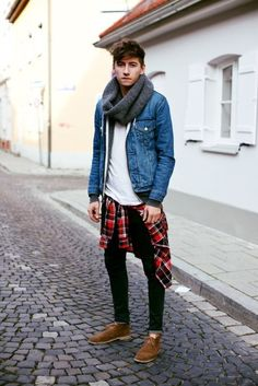 denim jacket with flannel shirt around the waist and jeans
