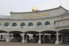 Churchill Downs Entrance The Kentucky Derby Museum is one of the best I've ever seen with lots of interactive exhibits and, projected around the balcony,  a slide show that had me in tears.