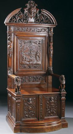 NORTHERN ITALIAN RENAISSANCE STYLE CARVED WALNUT THRONE CHAIR 19th century, the back panel with a relief carved classical scene of warriors and cherubs below a foliate and reticulated arched crest with winged cherubs head. The seat raised on a classical carved panel base below a pair of full figured seated lion arm rests.