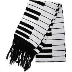 For those cold winter days and nights, this heavy duty scarf, with black and white piano keys woven in, has been one of the most popular items in our line for many years.
