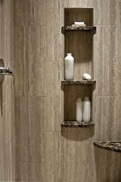 1. contrasting shower shelves  2. tiles would always look clean as water would fall to match pattern on tiles