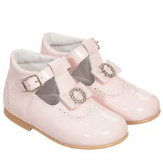 Girls patent pink leather shoes from Children's Classics. These very smart shoes have padded ankle support and fasten with a buckle. They have a pretty bow with diamanté decoration and cut-out detailing across the toes. Fully lined in leather, they have a cushioned instep for arch support and smooth rubber soles.