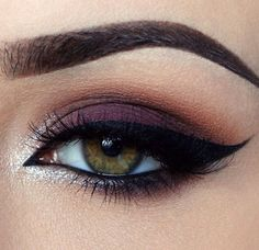 eye makeup, dark purple eye shadow, strong dark eyeliner and white shimmer in the inner eye corners