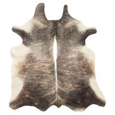 Luxurious on its own or layered atop a complementing rug, this handmade cowhide design brings a touch of rustic glamour to your decor. ($354) sizes vary