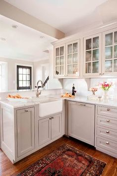 Light grey + white kitchen: view #2.  Love the farmhouse sink and cabinet panel to hide the dishwasher.
